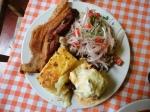 arequipa peruvian food triple rocoto relleno pastel papa chancho zarsa patitas